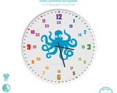 Personalisierbare Lernuhr für Kinder mit 24 Stunden Anzeige als Regenbogenuhr Geräuschlose Wanduhr Krake