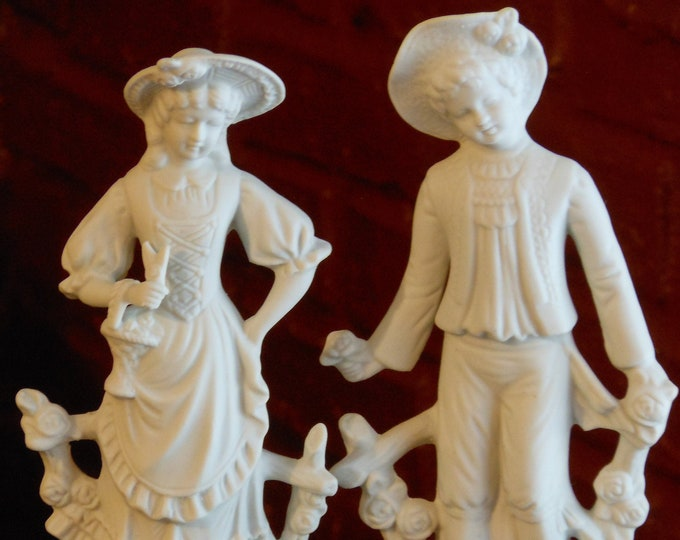 Two White Bisque Porcelain Mold Figurines (Boy & Girl)