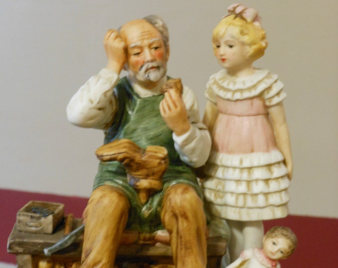 Dave Grossman Porcelain Bisque Figurine: Norman Rockwell Collection. The Cobbler.