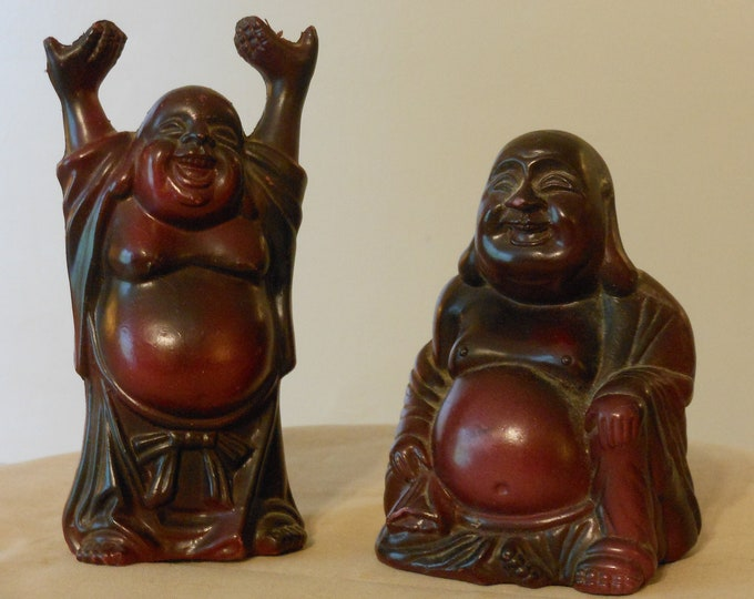 A Pair of Plastic Brown Buddhas