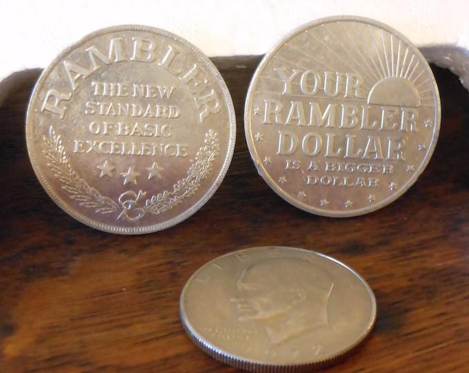 Two Vintage Rambler Dollars Advertising Tokens