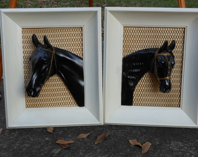 A Pair of Framed 3-D Black Resin Horses