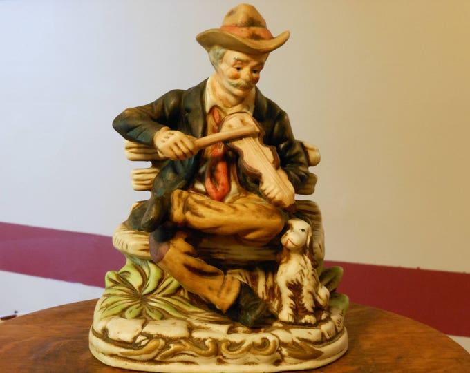 Vintage Porcelain Bisque Figurine, a Fiddler and His Dog