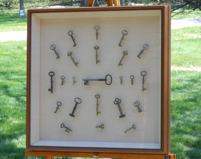 Twenty-three Framed Skeleton Keys in a Shadowbox