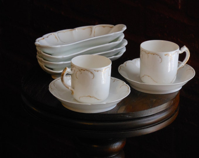 Two Limoges Demitasse Cups with Saucers and Four Half-Moon Plates