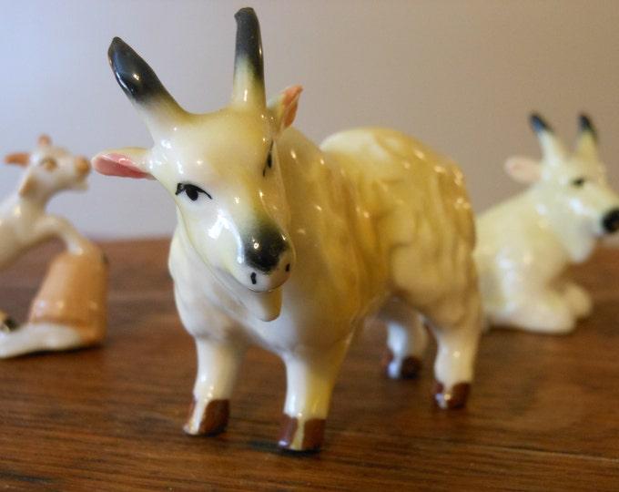 Four Bone China Miniature Mountain Goats & a Ram