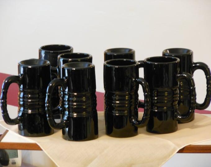 Eight Tall High Gloss Black Steins