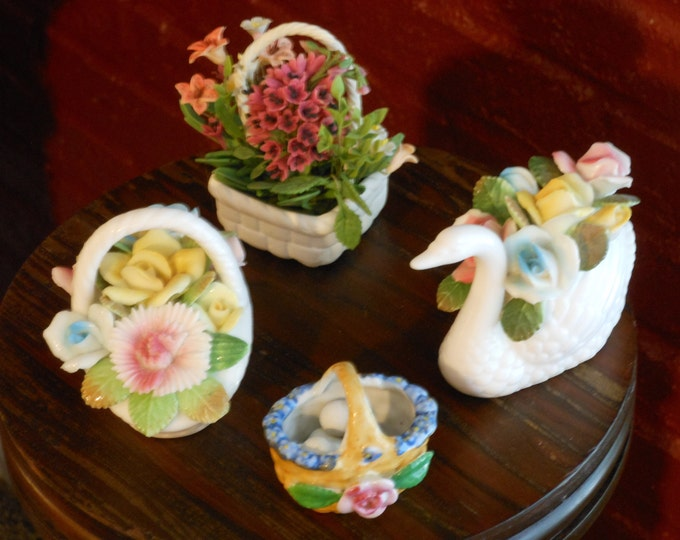 A Collection of Four Ceramic Baskets