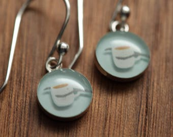 Tiny coffee cup earrings made from recycled Starbucks gift cards. sterling silver and resin.