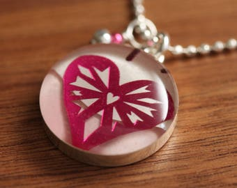 shiny pink heart necklace made from recycled Starbucks gift cards, sterling silver and resin.