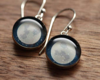 Full moon earrings made from recycled Starbucks gift cards, sterling silver and resin.