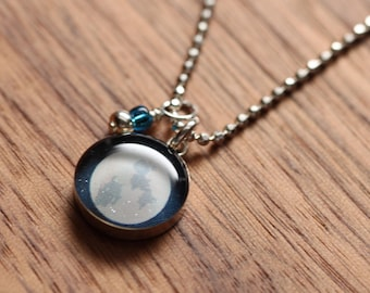 Full moon necklace made from recycled Starbucks gift cards, sterling silver and resin.