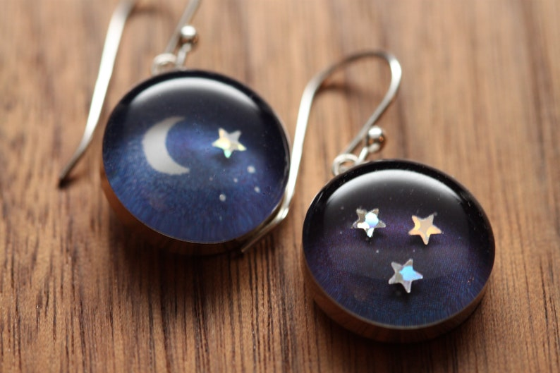 Moon earrings made from recycled Starbucks gift cards sterling silver and resin.