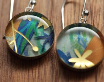Jungle flower earrings made from recycled Starbucks gift cards. sterling silver and resin.