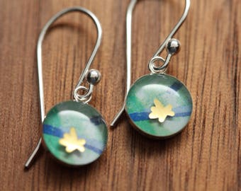 Tiny golden flower earrings made from recycled Starbucks gift cards. sterling silver and resin.