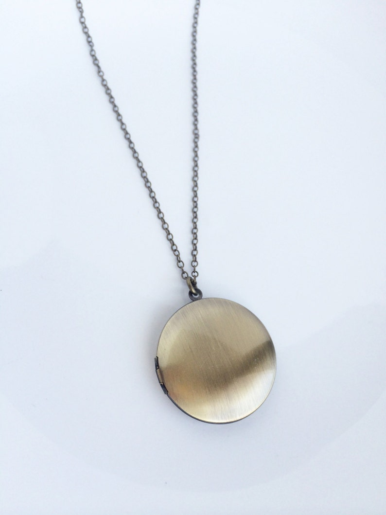 Andromeda \u2022 Round locket necklace