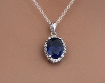 441729e91a9094 Sterling Silver Blue Oval CZ Pendant Circled in Clear CZ Stones  Necklace,Beautiful Sterling Silver Blue Oval CZ Charm Necklace