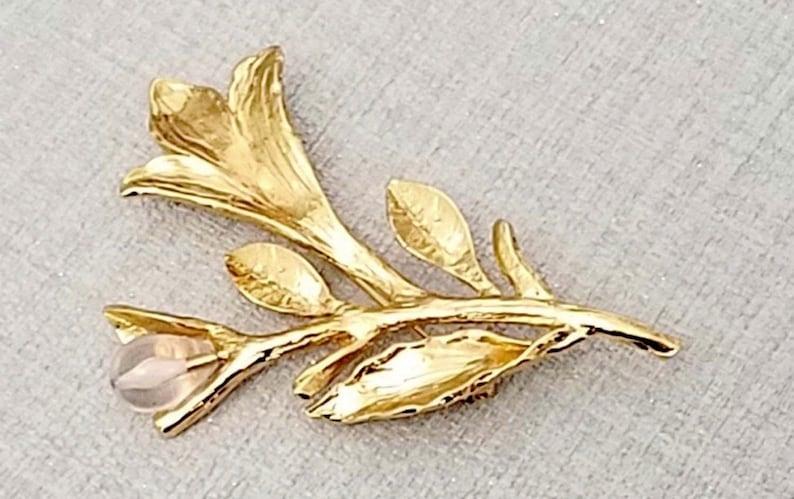 ea35b581679 Brooch YVES ST LAURENT gold plated vintage | Etsy