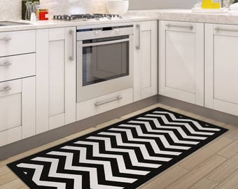 Black and white chevron area rug, printed linoleum rug, vinyl mat. Art Mat with zigzag geometric design.