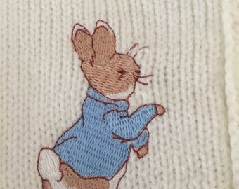 Knitted cardigan with peter rabbit embroidery
