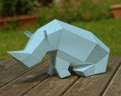Sitting Rhino Paper Sculpture in Iceberg Color, DIY papercraft set, foldable paper animal, Paperwolf geometric polygon look