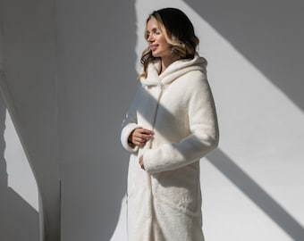 Eco fur coat with insulation and hood
