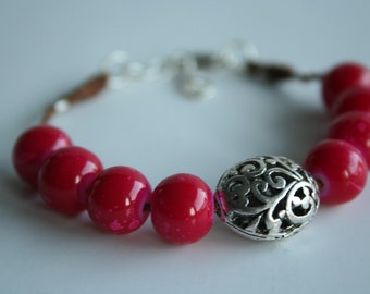Pink Beaded Bracelet with Silver Round Filigree Bead