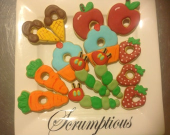 18 iced Hungry Caterpillar iced cookies.