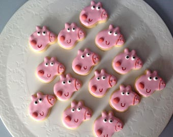 24 Mini Peppa Pig face iced cookies.
