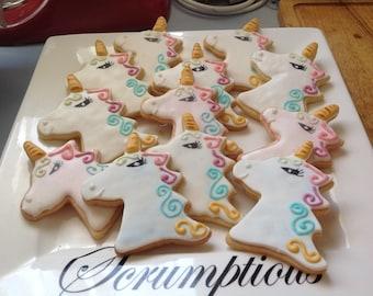 12 Unicorn iced cookies.