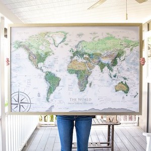 Framed world map etsy world map push pin world map wall art includes the usa national parks professional cartography with terrain and ocean elevation modeling gumiabroncs Image collections