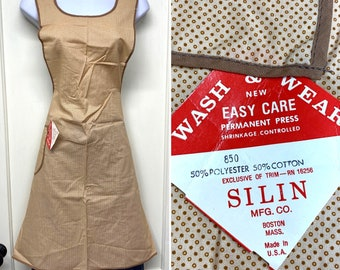 1960s deadstock pinafore apron with tiny polka dot print patterned piping a pocket and ties in back NWT