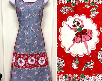 1950s blue cotton pinafore apron with ballerina and flower print piping pockets ties in back