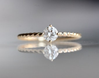 "14K Gold Diamond Solitaire ""Twist"" Engagement Ring"