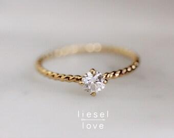 "14K Gold Diamond Solitaire ""Twist"" Engagement Ring"