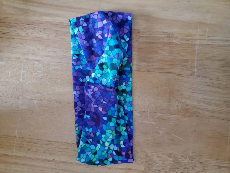 This one of a kind vibrant mosaic print adult headband.