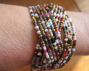 Several intersecting rows, multicolored beaded bracelet