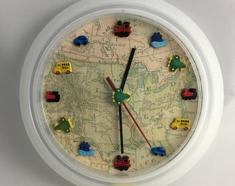 Travel related battery clock displays a map and forms of transportation, it would make a lovely gift for someone that likes to travel..