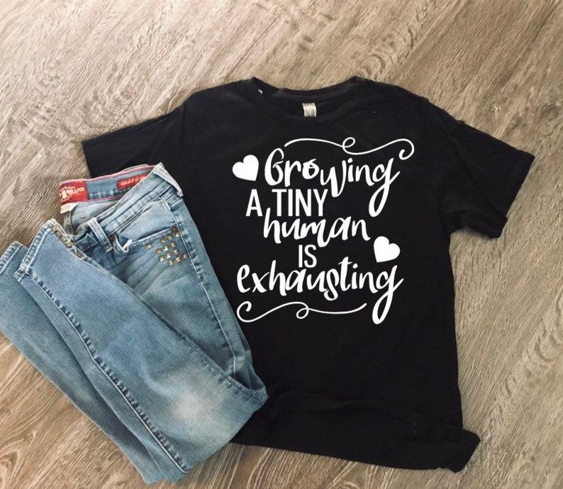 d69ebf033 Growing A Tiny Human Is Exhausting Shirt Maternity Shirt