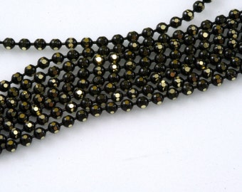 Faceted gold tone and black Brass Chain 33 feet  1,5 mm balls