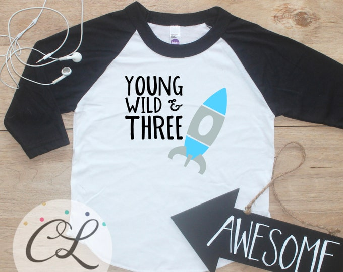Young Wild Three Space Birthday Boy Shirt / Baby Boy Clothes 3 Year Old Outfit Third Birthday TShirt 3rd Birthday Party Raglan Rocket 283