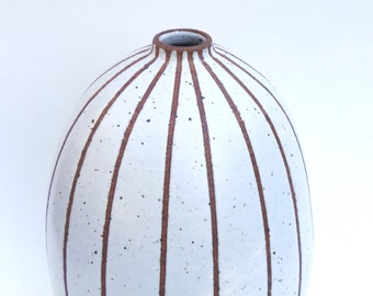 Handmade tall and chubby white ceramic vase with exposed clay pin-stripes