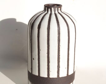 Handmade white narrow-striped ceramic bottle vase with exposed black/brown clay stripes