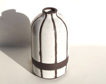 Handmade white wide-striped ceramic bottle vase with exposed black/brown clay stripes