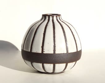 Chubby handmade white striped ceramic vase with exposed black/brown clay stripes