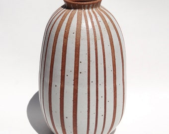 Handmade tall white ceramic vase with exposed clay stripes