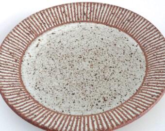Handmade, wheel thrown ceramic plate with matte white stripes