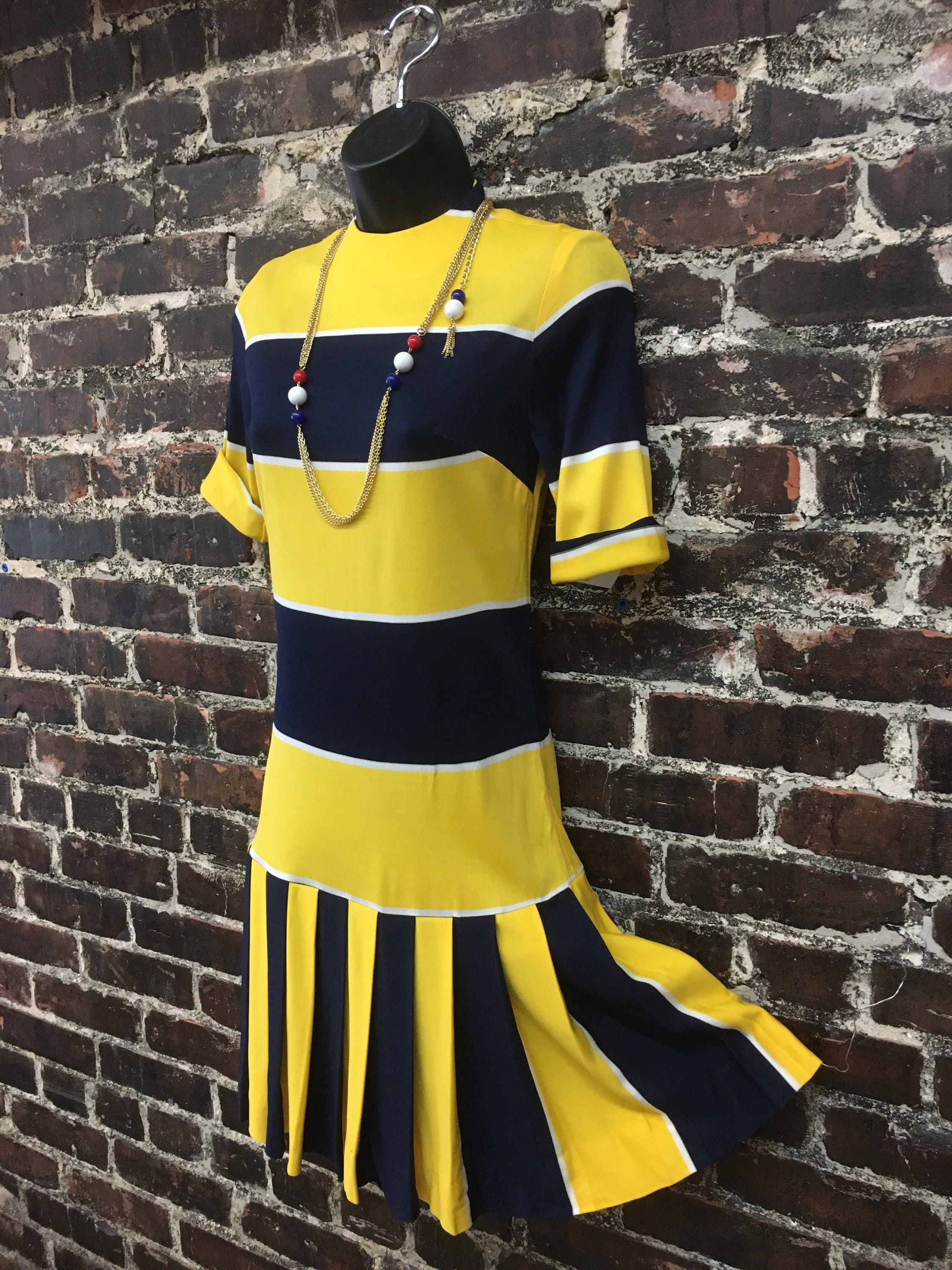60s -70s Jewelry – Necklaces, Earrings, Rings, Bracelets 1960S Yellow Striped Dress. 60S Drop Waist Dress With Pleated Skirt.  Navy Blue Stripes By Jerell Of Texas. Xxs Extra Small, 32 B $60.00 AT vintagedancer.com