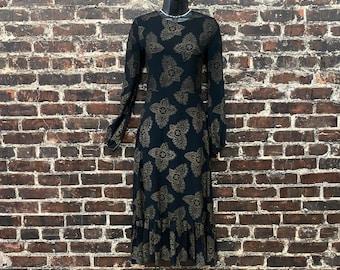 1970s Black and Gold Midi Dress with Paisley Mandala Print and Ruffle Hem. Margret Godfrey for Jack's Dress Company. Size Small, 34 B, 26 W