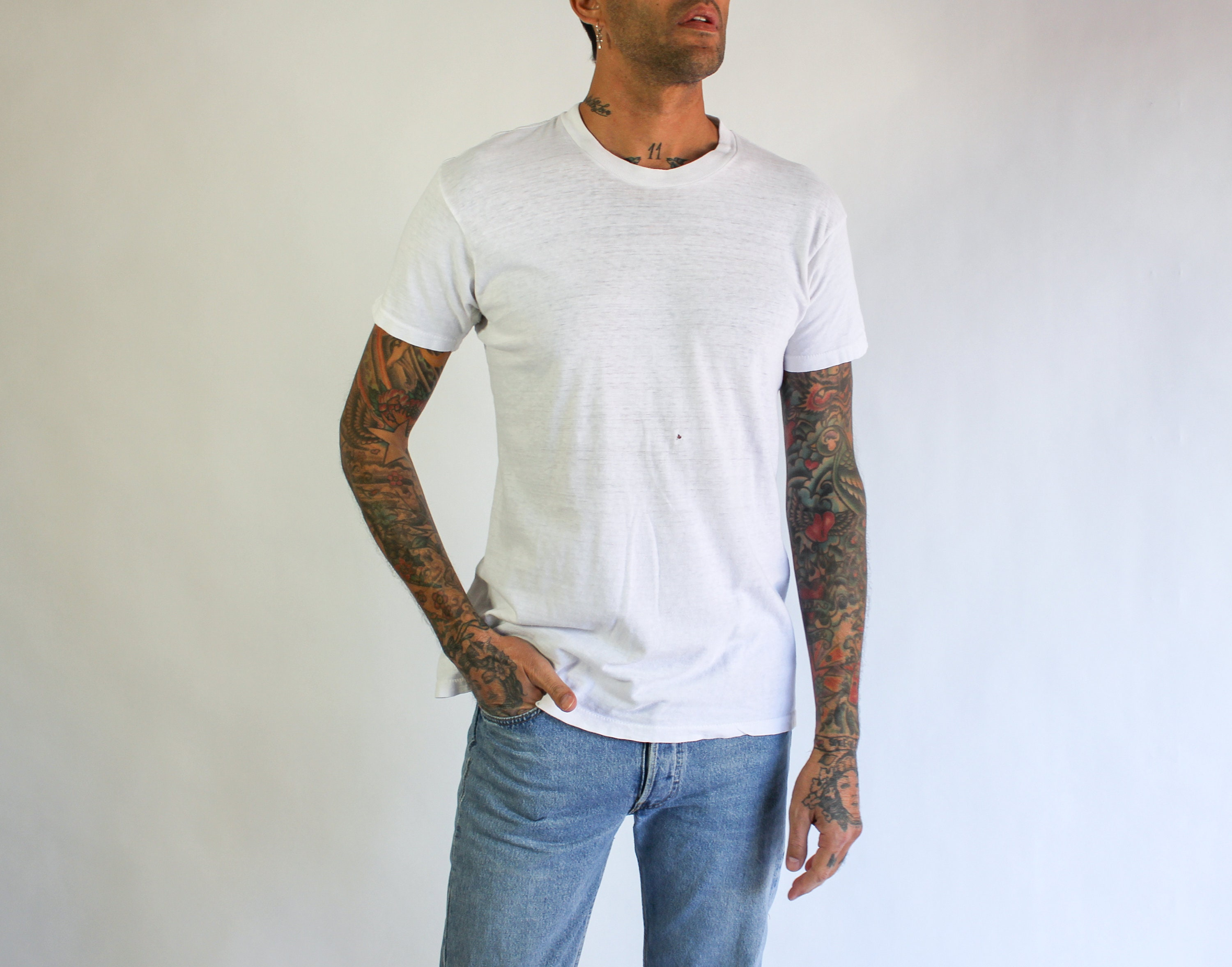 1970s Mens Shirt Styles – Vintage 70s Shirts for Guys Vintage 70S 80S Destroyed K Mart Blank Tee Shirt  Paper Thin, Single Stitch 1970S 1980S White $22.95 AT vintagedancer.com
